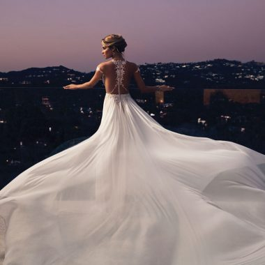 A bride stands on the rooftop in her gown