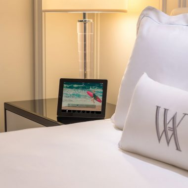 Fluffy pillows and a bedside iPad