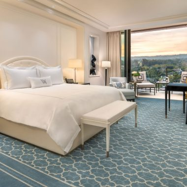 Spacious room with plush bedding and lush carpet
